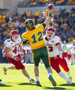North Dakota State quarterback Easton Stick (12) throws a pass in front of the rush of Eastern Washington linebacker Ketner Kupp (40) and defensive lineman Nick Foerstel (92) during the first half of the FCS championship NCAA college football game, Saturday, Jan. 5, 2019, in Frisco, Texas. (AP Photo/Jeffrey McWhorter)