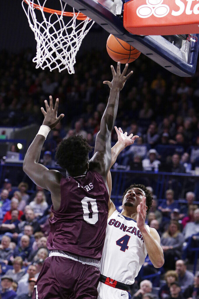 Gonzaga guard Ryan Woolridge (4) shoots while pressured by Texas Southern forward Yahuza Rasas (0) during the first half of an NCAA college basketball game in Spokane, Wash., Wednesday, Dec. 4, 2019. (AP Photo/Young Kwak)