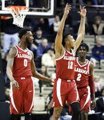 Alabama guard Dazon Ingram (12) celebrates in the closing seconds of an NCAA college basketball game against Vanderbilt, Saturday, Feb. 9, 2019, in Nashville, Tenn. Alabama won 77-67. With Ingram are Donta Hall (0) and Kira Lewis Jr. (2). (AP Photo/Mark Humphrey)