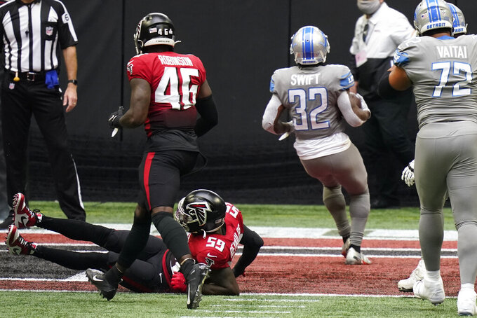 Detroit Lions running back D'Andre Swift (32) runs into the end zone for a touchdown against the Atlanta Falcons during the first half of an NFL football game, Sunday, Oct. 25, 2020, in Atlanta. (AP Photo/Brynn Anderson)