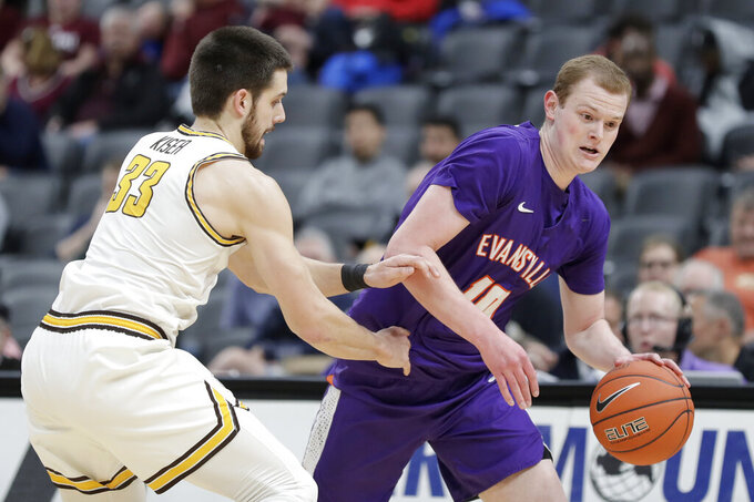 Evansville's Evan Kuhlman, right, heads to the basket as Valparaiso's John Kiser (33) defends during the first half of an NCAA college basketball game in the first round of the Missouri Valley Conference men's tournament Thursday, March 5, 2020, in St. Louis. (AP Photo/Jeff Roberson)