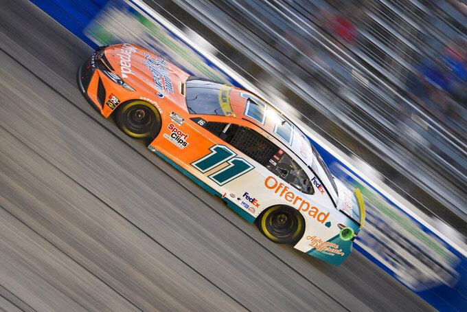 Denny Hamlin races in a NASCAR Cup Series auto race Sunday, Sept. 5, 2021, in Darlington, S.C. (AP Photo/John Amis)