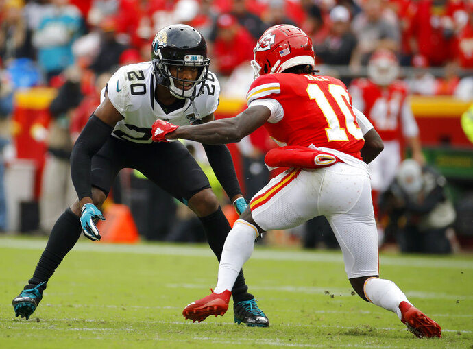 """FILE - In this Sunday, Oct. 7, 2018, file photo, Jacksonville Jaguars cornerback Jalen Ramsey (20) covers Kansas City Chiefs wide receiver Tyreek Hill (10) during the second half of an NFL football game in Kansas City, Mo. In a radio interview Wednesday, New England Patriots cornerback Stephon Gilmore's took a shot at the Ramsey by saying """"a lot of people can talk, but you've got to back it up, which he does. Sometimes."""" Ramsey fired back Thursday, saying """"we know that's furthest from the truth."""" Ramsey is widely considered the best cornerback in the NFL, a defender who usually plays press coverage and usually follows the opponent's best receiver all over the field.  (AP Photo/Charlie Riedel< File)"""