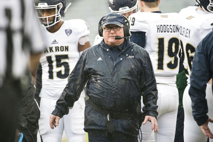 Akron head coach Terry Bowden walks back to the sideline after a timeout during the first half of an NCAA college football game Saturday, Dec. 1, 2018, in Columbia, S.C. South Carolina defeated Akron 28-3. (AP Photo/Sean Rayford)