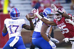 Oklahoma defensive lineman Isaiah Thomas (95) pressures Kansas quarterback Jalon Daniels (17) during an NCAA college football game in Norman, Okla., Saturday, Nov. 7, 2020. After winning a sixth conference title in a row, the No. 8 Sooners (8-2) will again end the season in a New Year's Six bowl game against a high-powered SEC offense. This time they face national passing leader No. 10 Florida.(AP Photo/Sue Ogrocki)