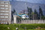A helicopter carrying former rebel leader Seuxis Hernandez takes off from La Picota jail in Bogota, Colombia, Friday, May 17, 2019. The former peace negotiator, best known by his alias Jesús Santrich, was re-arrested immediately after his release that was orderer by a special tribunal investigating war crimes during Colombia's civil conflict that ruled Wednesday that he should not be extradited to the United States. (AP Photo/Fernando Vergara)