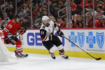Arizona Coyotes center Derek Stepan, right, controls the puck past Chicago Blackhawks defenseman Dennis Gilbert during the first period of an NHL hockey game Sunday, Dec. 8, 2019, in Chicago. (AP Photo/Nam Y. Huh)