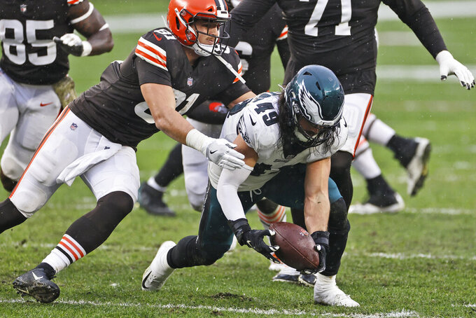 Philadelphia Eagles linebacker Alex Singleton (49) recovers a fumble during the second half of an NFL football game against the Cleveland Browns, Sunday, Nov. 22, 2020, in Cleveland. (AP Photo/Ron Schwane)
