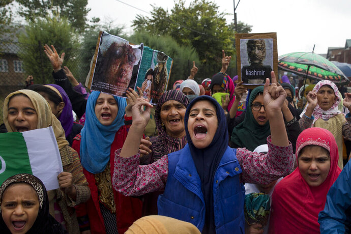 FILE- In this Oct. 4, 2019 file photo, Kashmiris shout slogans against India revoking Muslim-majority Kashmir's semi-autonomous status during a protest on the outskirts of Srinagar, Indian controlled Kashmir. India on Thursday asked China to avoid raising the Kashmir dispute at the United Nations Security Council, insisting it is a bilateral matter between India and Pakistan. (AP Photo/ Dar Yasin, File)