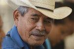 Salvadoran farmer Jorge Guevara smiles during the launch of the