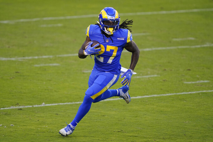 Los Angeles Rams running back Darrell Henderson Jr. (27) runs against the San Francisco 49ers during the first half of an NFL football game in Santa Clara, Calif., Sunday, Oct. 18, 2020. (AP Photo/Tony Avelar)