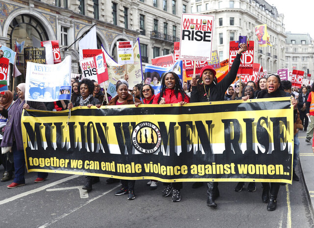 Women take part in the Million Women Rise march, to demand an end to male violence against women and girls in all its forms, a day ahead of International Women's Day, in central London, Saturday March 7, 2020. (Yui Mok/PA via AP)