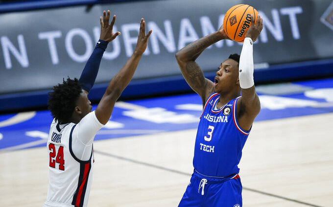 Louisiana Tech guard Amorie Archibald (3) looks to pass as Mississippi guard Jarkel Joiner (24) defends during the second half of an NCAA college basketball game in the NIT, Friday, March 19, 2021, in Frisco, Texas. (AP Photo/Brandon Wade)