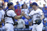 Milwaukee Brewers' Corey Knebel (46) is congratulated by Erik Kratz after recording a save after a baseball game against the Chicago Cubs Wednesday, June 13, 2018, in Milwaukee. The Brewers won 1-0. (AP Photo/Aaron Gash)