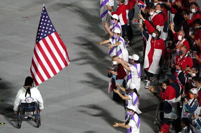 The flag of the United States enters the stadium during the closing ceremony for the 2020 Paralympics at the National Stadium in Tokyo, Sunday, Sept. 5, 2021. (AP Photo/Eugene Hoshiko)
