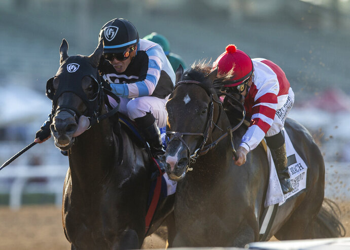 In a photo provided by Benoit Photo, Omaha Beach and jockey Mike Smith, right, overpower Shancelot, left, and jockey Emisael Jaramillo, to win the Grade I, $300,000 Santa Anita Sprint Championship horse race Saturday, Oct. 5, 2019, at Santa Anita in Arcadia, Calif. (Benoit Photo via AP)