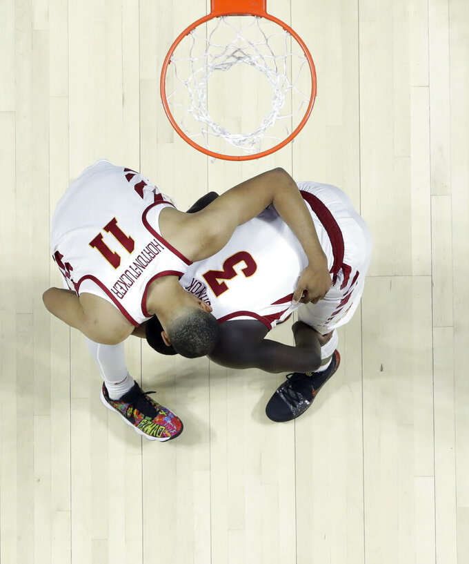Iowa State's Talen Horton-Tucker (11) consoles teammate Marial Shayok after a 62-59 loss to Ohio State during a first round men's college basketball game in the NCAA Tournament Friday, March 22, 2019, in Tulsa, Okla. Ohio State won 62-59. (AP Photo/Jeff Roberson)