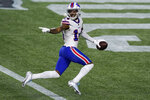 Buffalo Bills wide receiver Stefon Diggs crosses the goal line for a touchdown after catching a pass in the first half of an NFL football game against the New England Patriots, Monday, Dec. 28, 2020, in Foxborough, Mass. (AP Photo/Elise Amendola)