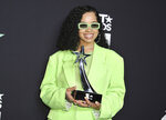 Ella Mai poses in the press room with the viewers' choice award for