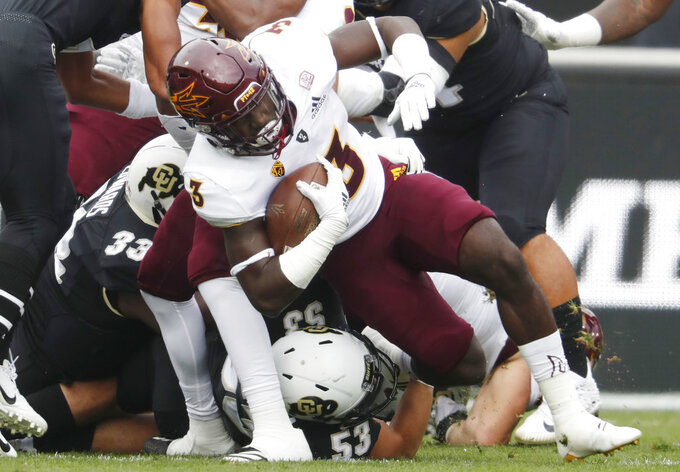 Arizona State running back Eno Benjamin, top, is tackled by Colorado linebacker Nate Landman in the first half of an NCAA college football game Saturday, Oct. 6, 2018, in Boulder, Colo. (AP Photo/David Zalubowski)