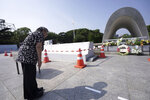 "Koko Kondo prays at the cenotaph for the atomic bombing victims near Hiroshima Peace Memorial Museum in Hiroshima, western Japan, Wednesday, Aug. 5, 2020. Kondo was determined to find the person who dropped the atomic bomb on Hiroshima, western Japan, the person that caused the suffering and the terrible facial burns of the girls at her father's church - and then square off and punch them in the face. Ten-year-old Kondo appeared on an American TV show called ""This is Your Life"" that was featuring her father, Rev. Kiyoshi Tanimoto, one of six survivors profiled in John Hersey's book ""Hiroshima."" Kondo stared in hatred at another guest: Capt. Robert Lewis, co-pilot of B-29 bomber Enola Gay that dropped the bomb. (AP Photo/Eugene Hoshiko)"