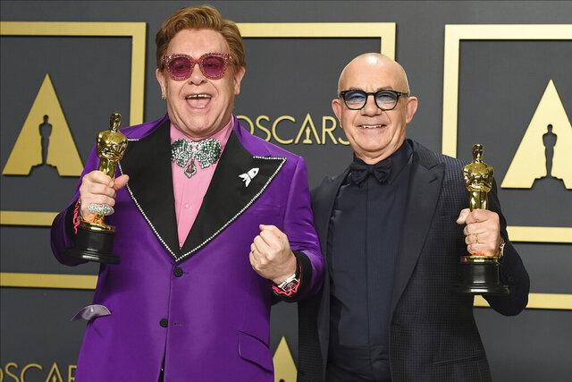 Elton John, left, and Bernie Taupin, winners of the award for best original song for
