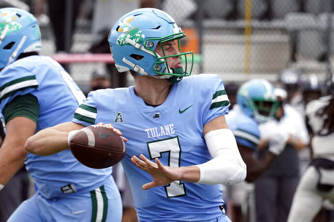Tulane quarterback Michael Pratt throws a pass against Central Florida during the first half of an NCAA college football game, Saturday, Oct. 24, 2020, in Orlando, Fla. (AP Photo/John Raoux)