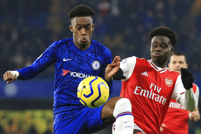 Chelsea's Callum Hudson-Odoi, left, fights for the ball with Arsenal's Bukayo Saka during the English Premier League soccer match between Chelsea and Arsenal at Stamford Bridge stadium in London England, Tuesday, Jan. 21, 2020. (AP Photo/Leila Coker)