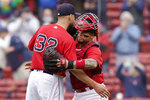 Boston Red Sox's Matt Barnes, left, celebrates with Christian Vazquez after defeating the Seattle Mariners in a baseball game, Sunday, April 25, 2021, in Boston. (AP Photo/Steven Senne)