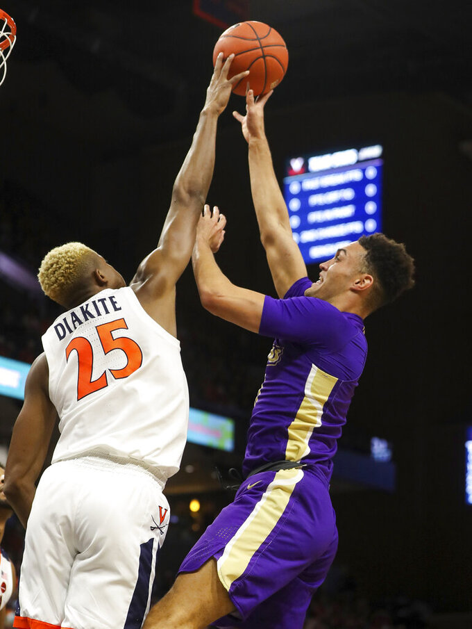 Virginia forward Mamadi Diakite (25) blocks a shot by James Madison forward Zach Jacobs (11) during an NCAA college basketball game in Charlottesville, Va., Sunday, Nov. 10, 2019. (AP Photo/Andrew Shurtleff)