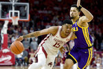 FILE - In this March 4, 2020, file photo, Arkansas guard Mason Jones (15) drives against LSU defender Skylar Mays (4) during the first half of an NCAA college basketball game in Fayetteville, Ark. Jones was selected to the Associated Press All-SEC first team announced Tuesday, March 10, 2020. Jones also tied for AP SEC Player of the Year. (AP Photo/Michael Woods, File)