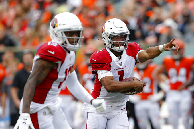 Arizona Cardinals quarterback Kyler Murray (1) runs the ball in the first half of an NFL football game against the Cincinnati Bengals, Sunday, Oct. 6, 2019, in Cincinnati. (AP Photo/Gary Landers)