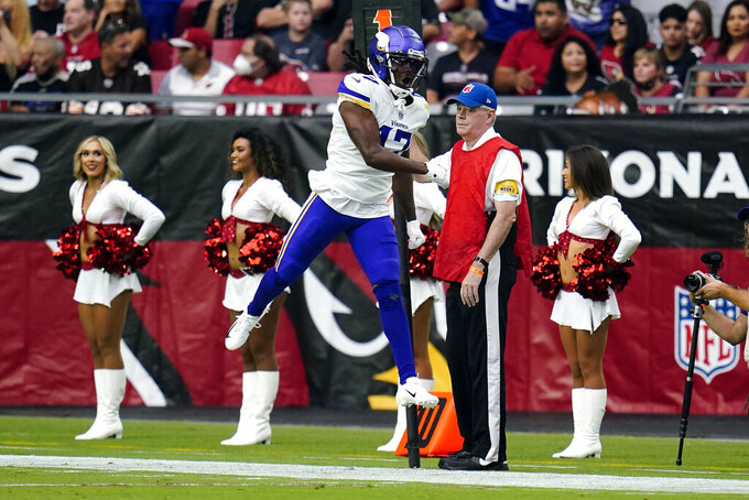 Minnesota Vikings wide receiver K.J. Osborn (17) celebrates his touchdown against the Arizona Cardinals during the first half of an NFL football game, Sunday, Sept. 19, 2021, in Glendale, Ariz. (AP Photo/Ross D. Franklin)