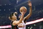 Toronto Raptors guard Jeremy Lin (17)gets fouled on his way to the hoop by New York Knicks centre Mitchell Robinson (26) during first half NBA basketball action in Toronto, Monday, March 18, 2019. (Frank Gunn/The Canadian Press via AP)