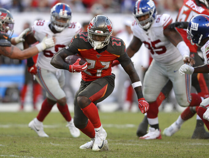 Tampa Bay Buccaneers running back Ronald Jones (27) runs against the New York Giants during the second half of an NFL football game Sunday, Sept. 22, 2019, in Tampa, Fla. (AP Photo/Jason Behnken)