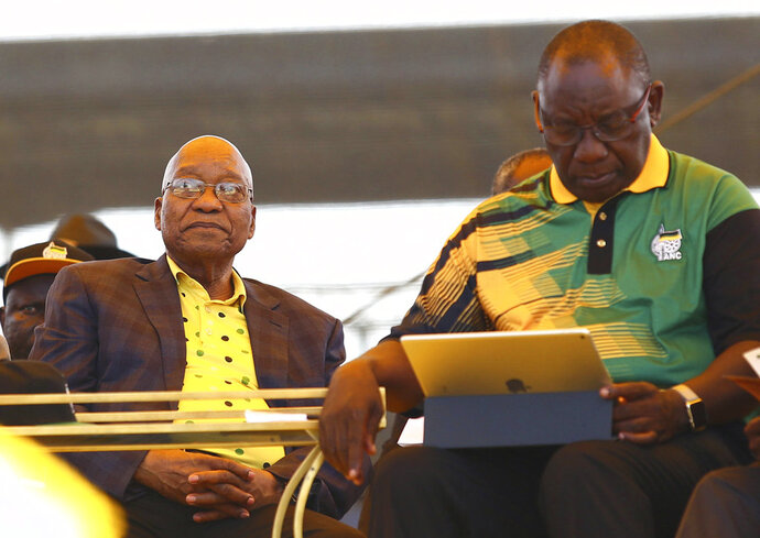 Newly-elected ruling African National Congress (ANC) party president, Cyril Ramaphosa, right, and former ANC President and South African President Jacob Zuma, left, attend the party's 106th birthday celebrations in East London, South Africa, Saturday, Jan. 13, 2018. Ramaphosa, addressed supporters for the first time since being elected last month. (AP Photo)