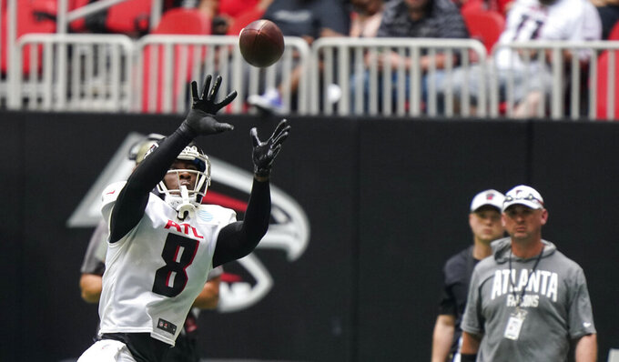 Atlanta Falcons tight end Kyle Pitts (8) catches a ball during NFL football practice on Saturday, Aug. 7, 2021, in Atlanta, Ga. (AP Photo/Brynn Anderson)