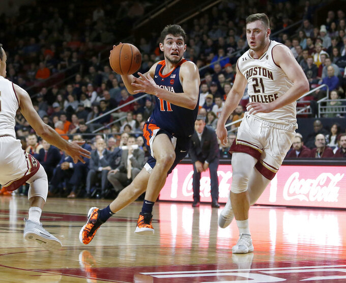 Virginia guard Ty Jerome (11) drives past Boston College forward Nik Popovic (21) during the first half of an NCAA basketball game Wednesday, Jan. 9, 2019, in Boston. (AP Photo/Mary Schwalm)