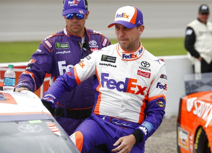 Denny Hamlin enters his car before the NASCAR cup series auto race at Michigan International Speedway, Monday, June 10, 2019, in Brooklyn, Mich. (AP Photo/Carlos Osorio)