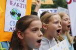Hundreds of schoolchildren take part in a climate protest in Hong Kong, Friday, March 15, 2019. Students in more than 80 countries and territories worldwide plan to skip class Friday in protest over their governments' failure to act against global warming. The coordinated 'school strike' was inspired by 16-year-old activist Greta Thunberg, who began holding solitary demonstrations outside the Swedish parliament last year. (AP Photo/Kin Cheung)