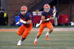 Illinois quarterback Artur Sitkowski (9) scrambles behind the blocking of Blake Jeresaty during the first half of an NCAA college football game against UTSA, Saturday, Sept. 4, 2021, in Champaign, Ill. (AP Photo/Charles Rex Arbogast)