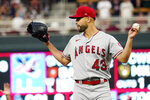 Los Angeles Angels pitcher Patrick Sandoval reacts after giving up a double to Minnesota Twins' Brent Rooker, spoiling his no-hitter, in the ninth inning of a baseball game, Saturday, July 24, 2021, in Minneapolis. (AP Photo/Jim Mone)