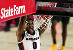 Georgia guard K.D. Johnson dunks during the second half of the team's NCAA college basketball game against Missouri, Tuesday, Feb. 16, 2021, in Athens, Ga. (AP Photo/Brynn Anderson)