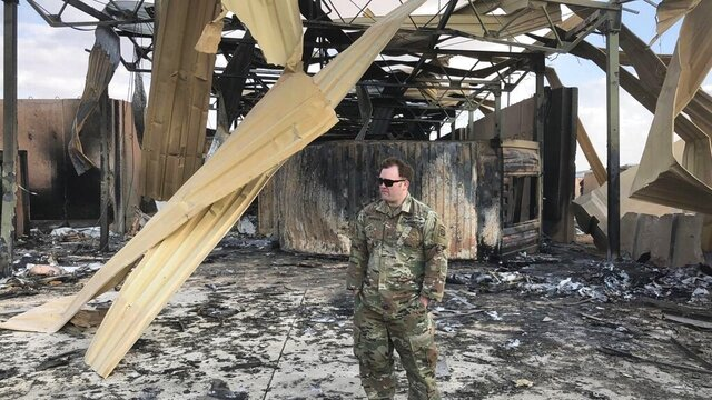 A U.S. soldier stands at a site of Iranian bombing, in Ain al-Asad air base, Anbar, Iraq, Monday, Jan. 13, 2020. Ain al-Asad air base was struck by a barrage of Iranian missiles on Wednesday, in retaliation for the U.S. drone strike that killed atop Iranian commander, Gen. Qassem Soleimani, whose killing raised fears of a wider war in the Middle East. (AP Photo/Qassim Abdul-Zahra)