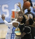 North Carolina's Caleb Love (2) drives to the basket against Wake Forest's Isaiah Mucius, right front, during the second half of an NCAA college basketball game Wednesday, Jan. 20, 2021, in Chapel Hill, N.C. (Robert Willett/The News & Observer via AP)