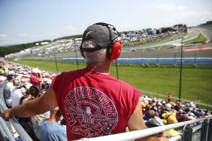 Fans watch from Turn 1 during a NASCAR Cup Series auto race at Watkins Glen International, Sunday, Aug. 4, 2019, in Watkins Glen, N.Y. (AP Photo/John Munson)