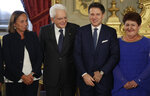 From left, Interior Minister Luciana Lamorgese, President Sergio Mattarella, Prime Minister Giuseppe Conte and Agriculture Minister Teresa Bellanova, pose during a swearing-in ceremony at the Quirinale Presidential Palace, in Rome, Thursday, Sept. 5, 2019. Italian Premier Giuseppe Conte forged a new coalition government Wednesday that teams up the populist 5-Star Movement and center-left Democrats in an unusual alliance of rivals to banish for now the specter of early election that likely could have seen the triumph of Italy's fast-rising right-wing forces. (AP Photo/Andrew Medichini)