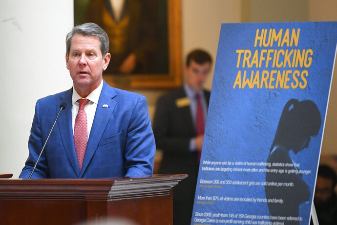 FILE - In this Monday, Jan. 13, 2020, file photo, Georgia Gov. Brian Kemp speaks on the rotunda about human trafficking during the opening day of the year for the general session of the state legislature in Atlanta. Georgia's Republican governor and first lady have announced Tuesday, Jan. 21, 2020, a slate of legislative measures they want to see enacted this year to combat human trafficking. (AP Photo/John Amis, File)