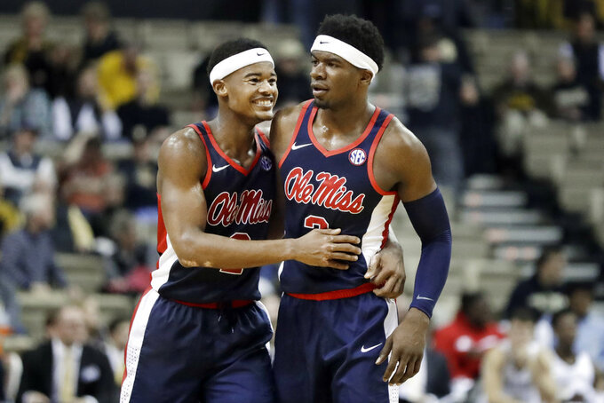 Mississippi's Devontae Shuler (2) and Terence Davis (3) celebrate after they defeated Vanderbilt in an NCAA college basketball game Saturday, Jan. 5, 2019, in Nashville, Tenn. (AP Photo/Mark Humphrey)