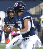 Utah State quarterback Jordan Love (10) looks to throw the ball to tight end Dax Raymond (87) against New Mexico during an NCAA college football game, Saturday, Oct. 27, 2018, in Logan, Utah. (Eli Lucero/The Herald Journal via AP)